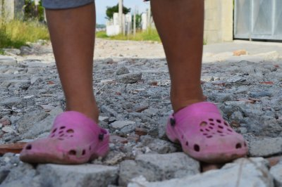 The boy in pink shoes shines at school